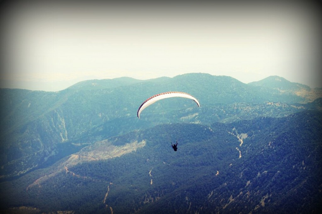 Mountains and parachutist.
